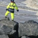 Worker on beach defenses — Stock Photo