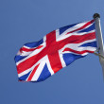 Union Jack against blue sky — Stock Photo