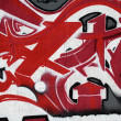 Red and white graffiti - Stock Photo