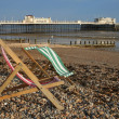 Deckchairs and pier — Stock Photo