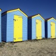 Blue and yellow beach huts — Stock Photo