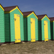Green and yellow beach huts — Stock Photo
