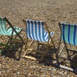 Three deckchairs — Stock Photo