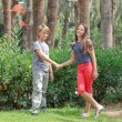 Boy and girl n the park. - Stock Photo
