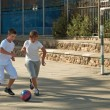 Two boys  playing football. - Foto Stock