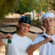 Royalty-Free Stock Photo: Two young boys with tennis racket .