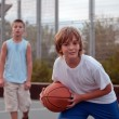 Royalty-Free Stock Photo: Kids play basketball in a school.