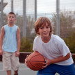 Stock Photo: Kids play basketball in school.