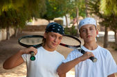 Two young boys with tennis racket . — Stock Photo