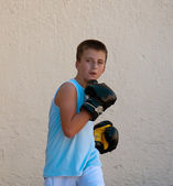 Boxing gloves on children hands . — Stock Photo