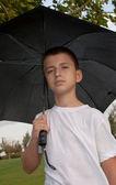Boy with an umbrella . — Стоковое фото