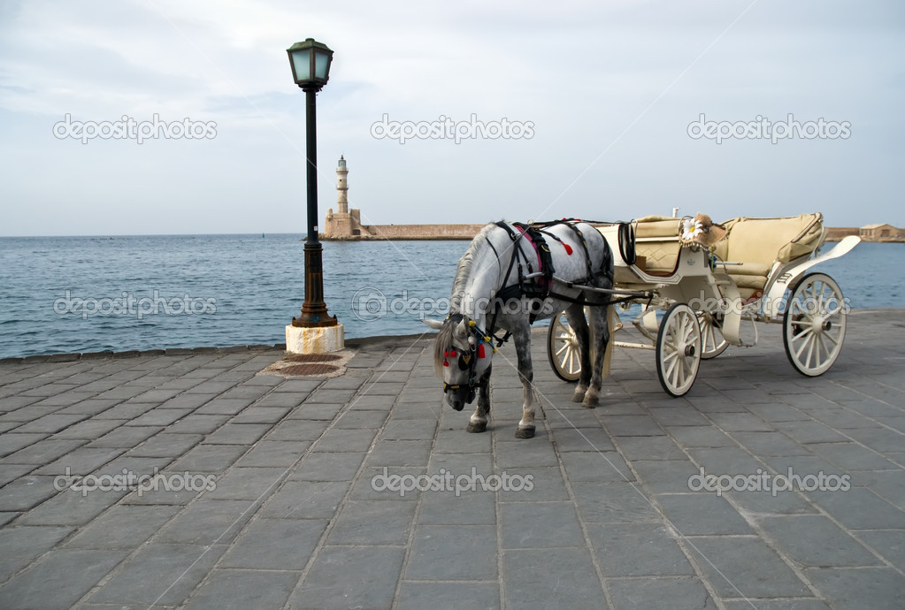 Traditional Horse and Cart on quay of city of island Crete, Greece . — Stock Photo #4546379