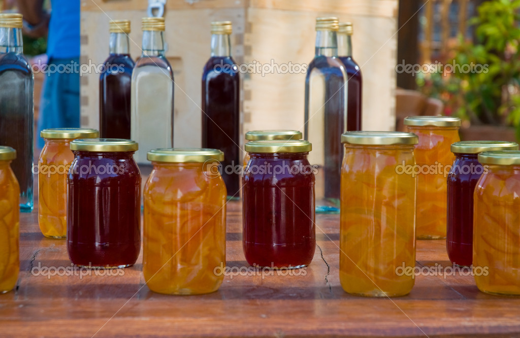 Jam at bank and liquors in bottles.Market in Greece. — Stock Photo #4546528