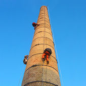 Workers on chimney — Stock Photo