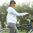 Stock Photo: Athletic female exercises with bicycle.