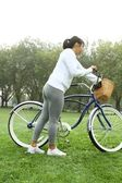 Athletic female exercises with bicycle. — Stock Photo