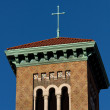 Stock Photo: Cross placed on church roof.