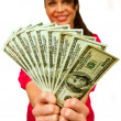 Stock Photo: Attractive female model holds $100's