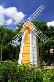 Yellow windmill netherlands style in blue sky — Stock Photo