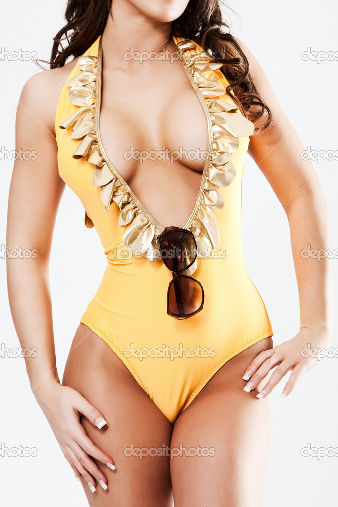 Body of babe in yellow bikini suite standing isolated — Stock Photo #4431281