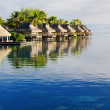 Amazing tropical resort with huts over water — Stock Photo