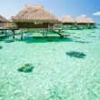 Over water bungalow with steps into amazing lagoon - Stock Photo