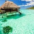 Over water bungalow with steps into amazing lagoon — Stock Photo #4473956