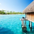 Stock Photo: Over water bungalow with steps into amazing lagoon