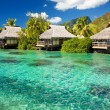 Over water bungalow with steps into amazing lagoon — Stockfoto