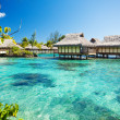 Over water bungalows with over amazing lagoon - Stock Photo
