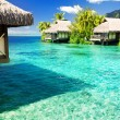 Over water bungalows with steps into amazing lagoon - Stock Photo