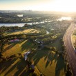 Sunshine over early morning in Brisbane from air - Stock Photo