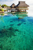 Over water bungalows over amazing coral lagoon — Stock Photo