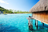 Over water bungalow with steps into amazing lagoon — Stock Photo