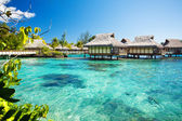 Over water bungalows with over amazing lagoon — Stock Photo
