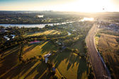 Sunshine over early morning in Brisbane from air — Stock Photo
