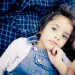 Gorgeous baby girl relaxing in father's lap - ストック写真
