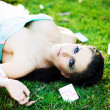 Young mysterious woman with cards in the grass — Stock Photo #4526131