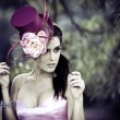 Face of young beautiful woman in a vintage hat - Stockfoto