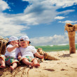 Royalty-Free Stock Photo: Identical twin boys relaxing on a beach