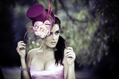Face of young beautiful woman in a vintage hat — Stock Photo