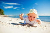 Little toddler on the beach exploring sand — Stock Photo