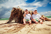 Identical twin boys relaxing on a beach — Stockfoto