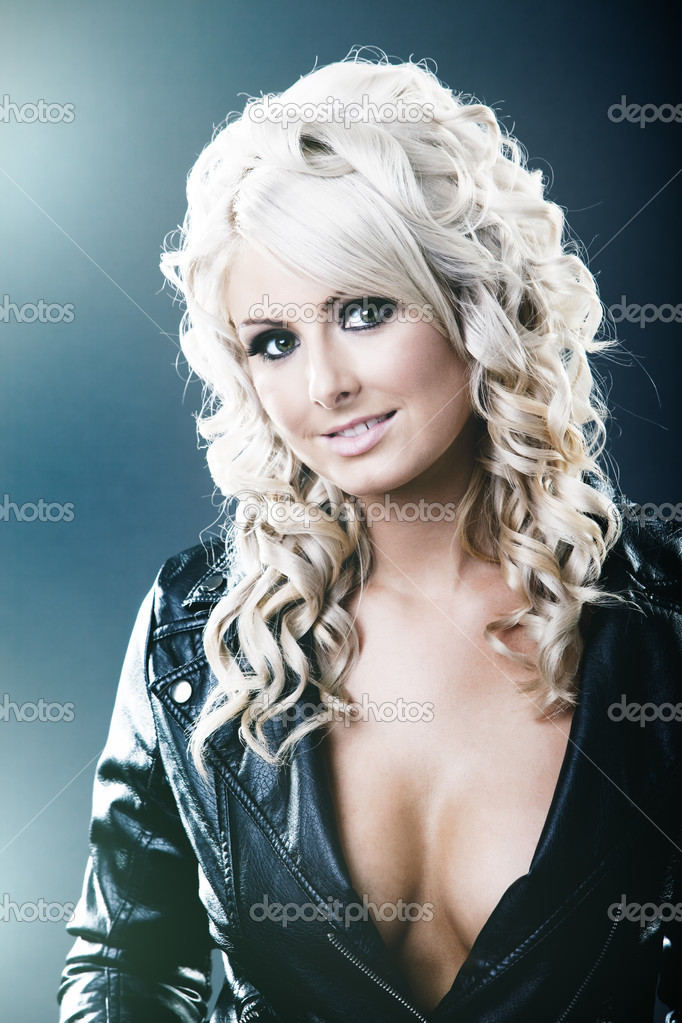 Young woman in black leather jackat with cleavage — Stock Photo #4525779