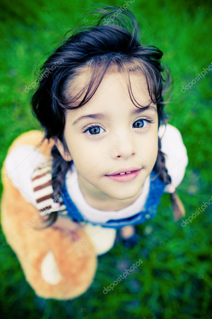 Young gorgeous girl with huge eyes looking into camera — Stock Photo #4525827