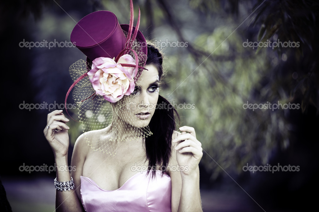 Face of young beautiful woman in a vintage hat outdoors — Stock Photo #4526134