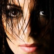 Mysterious female with wet hair — Stock Photo