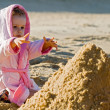 Child reaching for a sand on the beach — Stock Photo #4728435