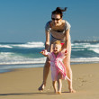 Young mother with daughter on the beach — Stock Photo #4728436