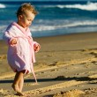 Baby walking on the beach — Stock Photo
